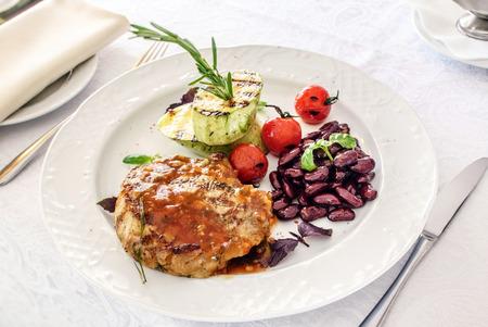 flesh eating animal: steak with grilled vegetables