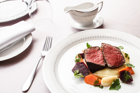 restaurant food: steak with vegetables Stock Photo