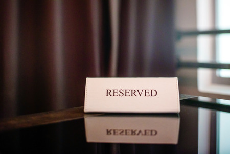 reserved seat: Restaurant reserved table sign Stock Photo