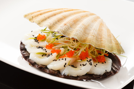 scallop shell: scallops presented on a scallop shell