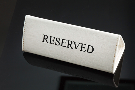 ifestyle: Restaurant reserved table sign Stock Photo