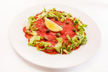 lemon slices: beef carpaccio Stock Photo