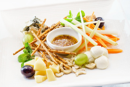 wine and dine: cheese plate Stock Photo