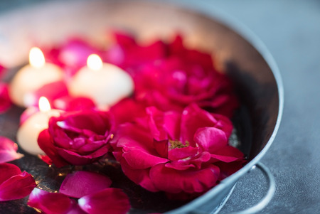 spa flower: red roses and candles Stock Photo
