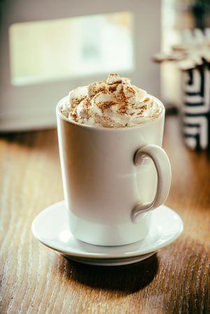 chocolate caliente: hot chocolate with whipped cream
