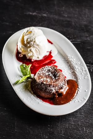 black and red: chocolate cake with ice cream Stock Photo