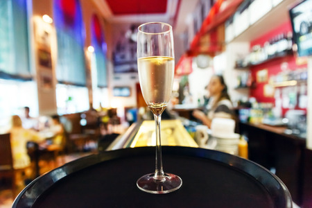 skoal: glass of champagne in cafe Stock Photo