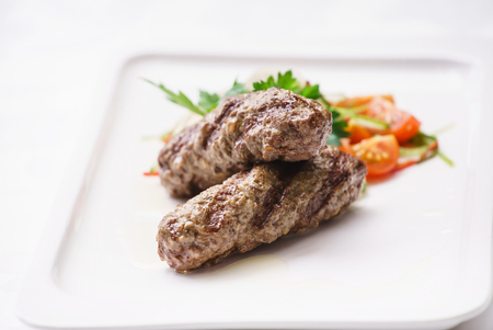 seekh: kebab with salad