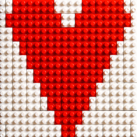 plastic heart: Heart from plastic bricks Stock Photo