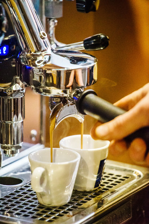 unrecognisable people: barista making coffee