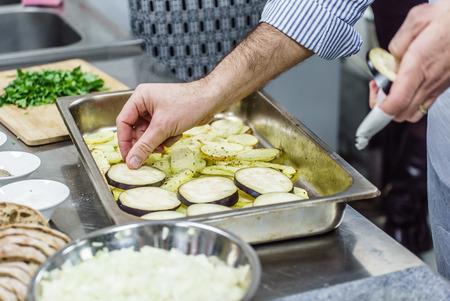 greek chef: chef making moussaka Stock Photo