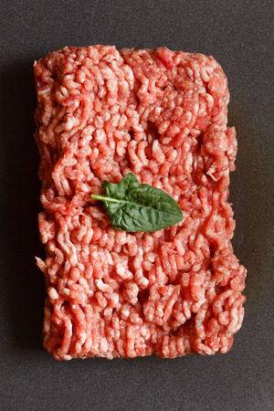 minced: minced meat with spinach Stock Photo