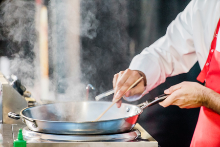finishing: chef at work Stock Photo