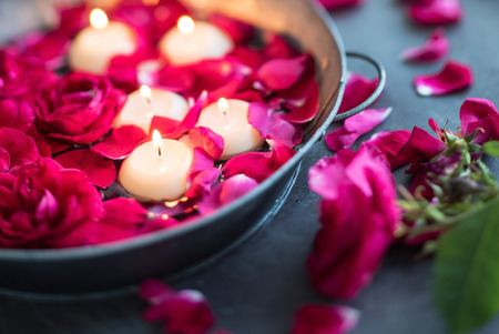light red: red roses and candles Stock Photo