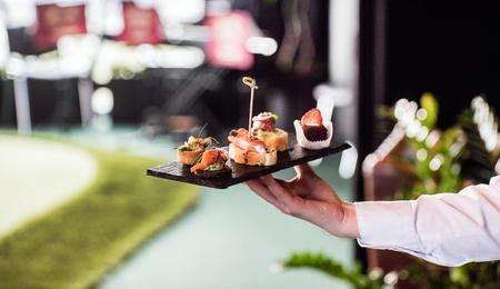 waiter with spanish appetizer Foto de archivo