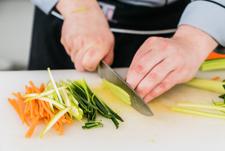 cutting vegetables: chef cutting vegetables Stock Photo