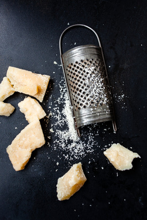grater: Parmesan cheese with a grater