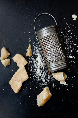 Parmesan cheese with a grater Фото со стока - 55685234
