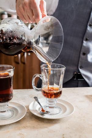 medium shot: barista making coffee