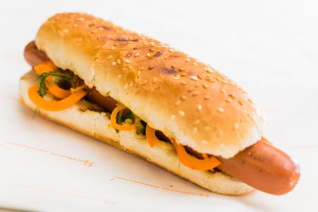 sesame seed bun: sausage in a sesame seed bun