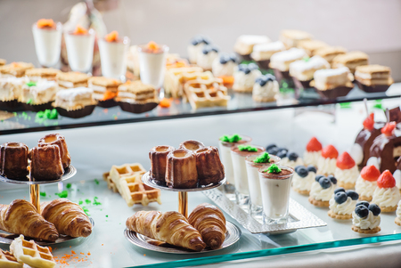 chocolaty: pastries on the branch table Stock Photo