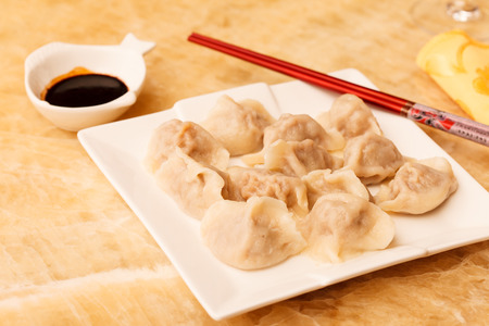 wor: Jiaozi - Chinese dumplings filled with pork and spring onions.