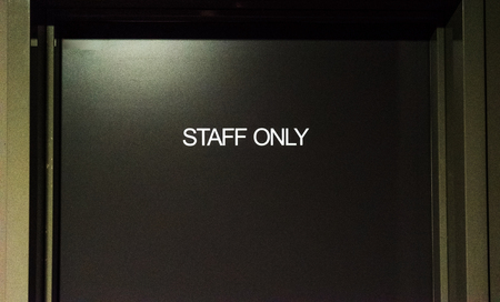 staff only: STAFF ONLY signage on a door