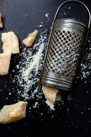 Parmesan cheese with a grater Фото со стока - 58648246