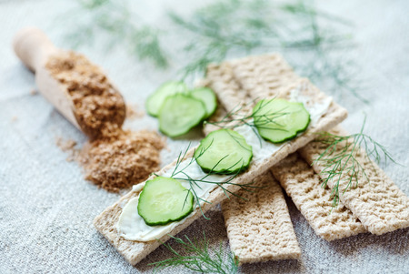 Stack of crispbreads with cream cheese Stock Photo