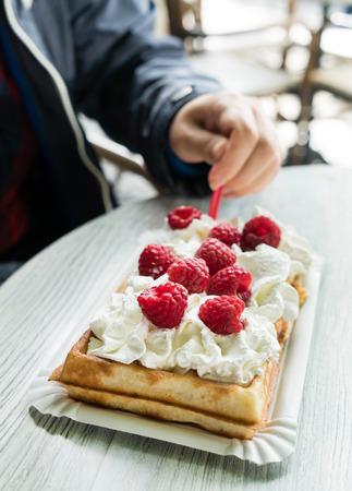 belgian: women eating belgian waffles