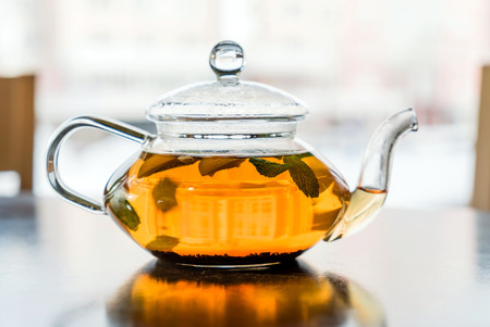 infused: glass teapot with tea