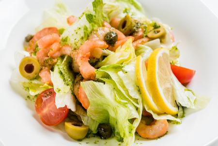lemon wedge: salad with shrimps