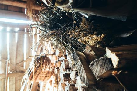 log basket: basket in old barn Stock Photo