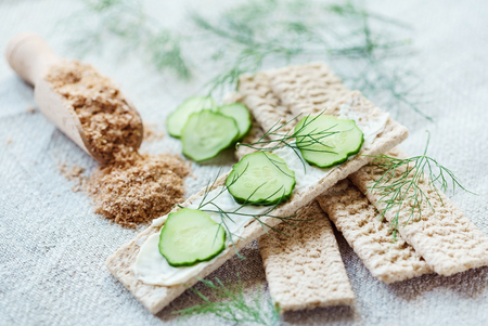 caloric: Stack of crispbreads with cream cheese Stock Photo