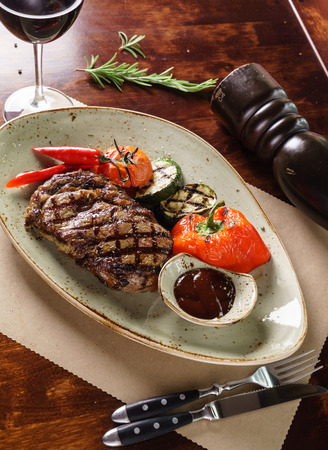 flesh eating animal: steak with vegetables Stock Photo