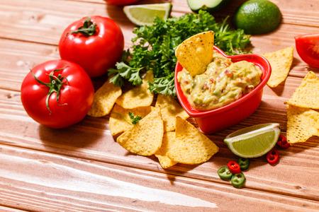 Guacamole with avocado, lime, tomato, and cilantro