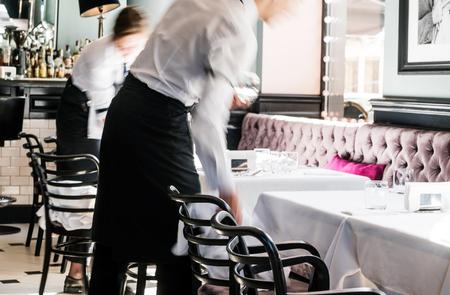 waiter in the restaurant Foto de archivo