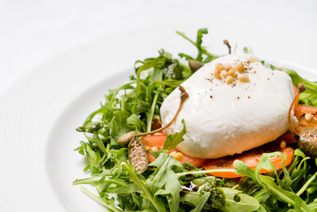 caper: salad with poached egg