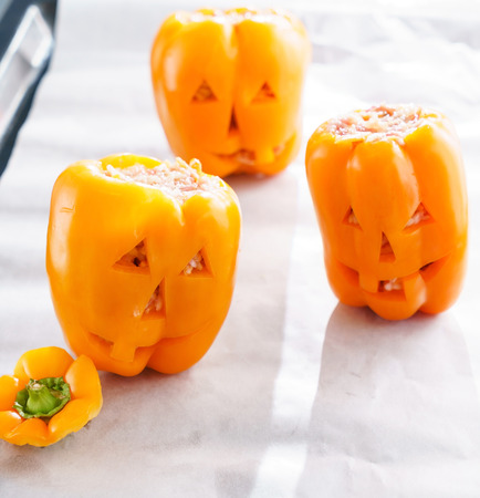filled: Halloween jack-o-lanterns filled with minced meat Stock Photo