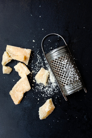 Parmesan cheese with a grater