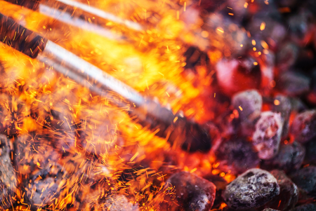 briquettes: Glowing charcoal and flame