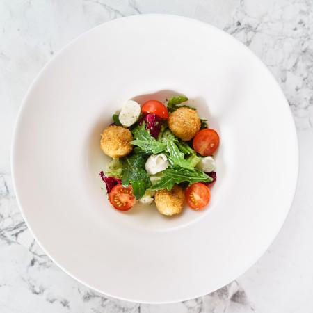 plates of food: salad with fried mozzarella balls
