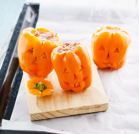 minced meat: Halloween jack-o-lanterns filled with minced meat Stock Photo