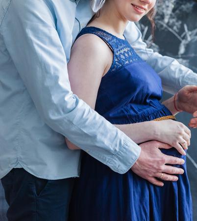 unborn: Man embraces his pregnant woman