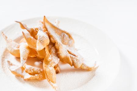 brushwood: Sweet thin crispy cookies Brushwood deep fried topped with powdered sugar