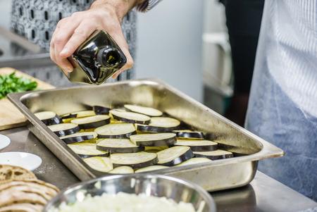chef making moussaka Stock Photo