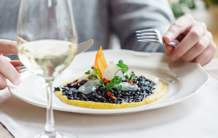 woman eating risotto