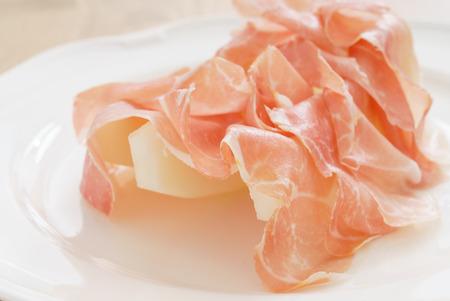 prosciutto with melon Фото со стока