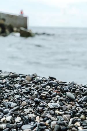 kiezels op het strand Stockfoto