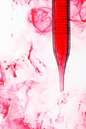 Pipette with red liquid